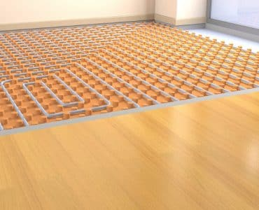 Underfloor heating system under wooden floor.